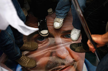 Feet on image of Assad