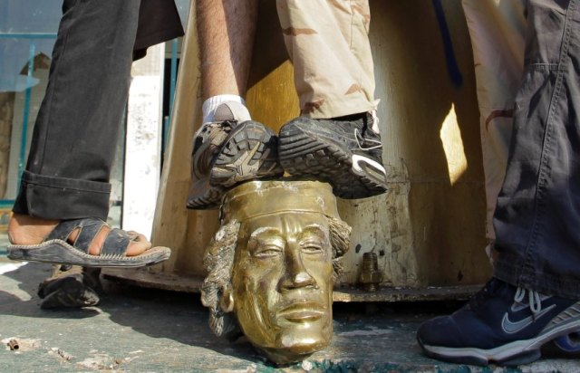 toppled Gaddafi statue