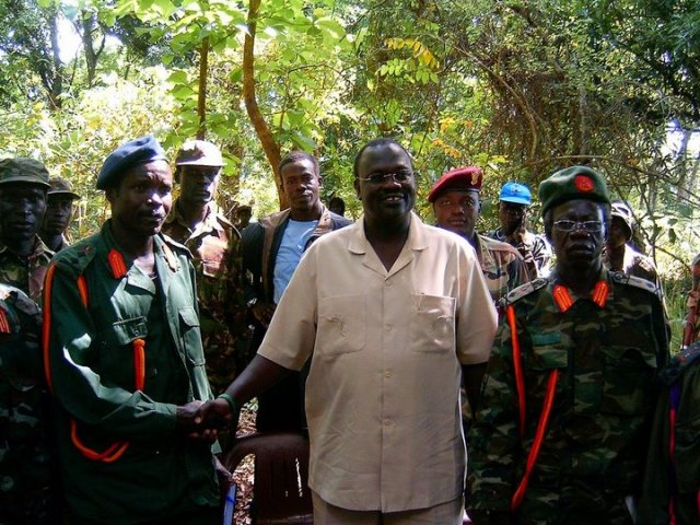 Joseph Kony (left) and his former second in command Vincent Otti (right), stand with Dr. Riek Machar, chief mediator of the Juba Peace Talks