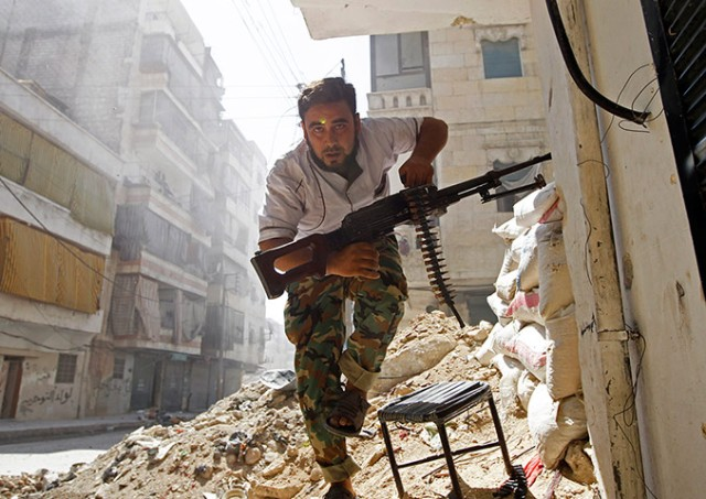 A Free Syrian Army fighter in Aleppo (Photo: Goran Tomasevic / Reuters)