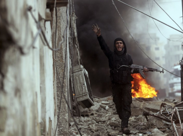 A Free Syrian Army fighter in Damascus(Goran Tomasevic/Reuters)