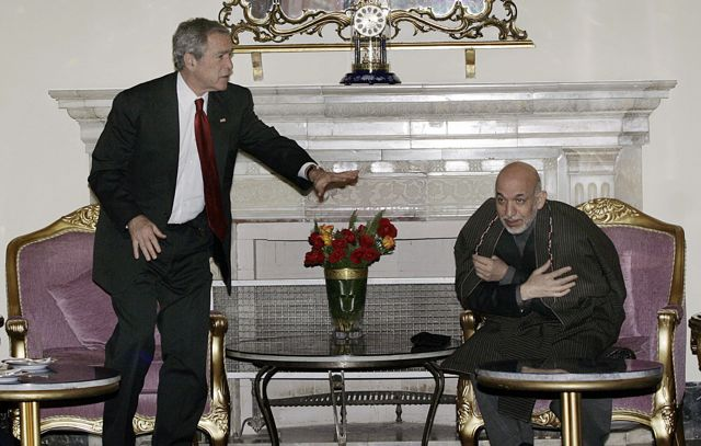 Afghan President Karzai with former US President George Bush. (Photo: Musadeq Sadeq / AFP / Getty Images)