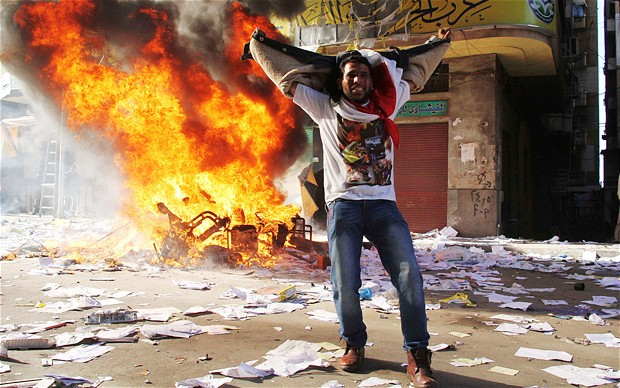 A protestor cheers after a Muslim Brotherhood office was ransacked (Photo: Reuters)