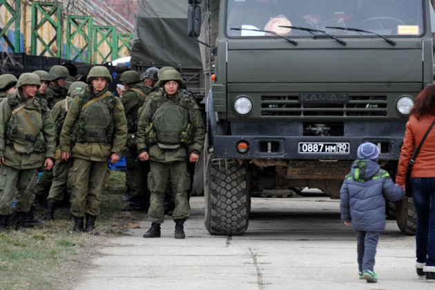 Troops stand near a Russian-made military truck in Feodosiya, Crimea (Photo: Viktor Drachev / AFP / Getty Images)