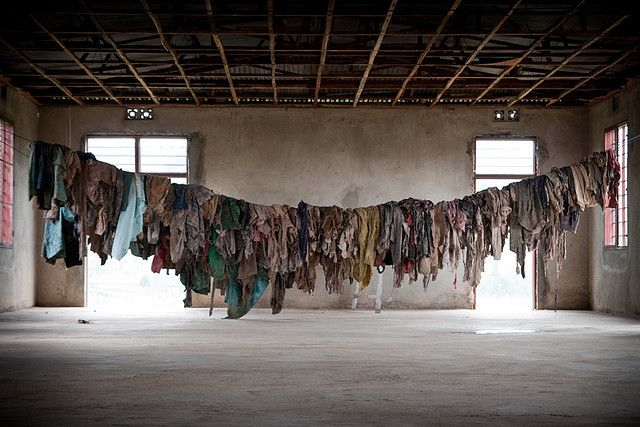 Clothes that belonged to victims of the Rwandan Genocide hang in the  Murambi Genocide Memorial Center (Photo: Shawna Nelles)