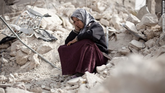 A woman sits amidst rubble in Aleppo (Photo: CNN, Pablo Tosco / AFP / Getty Images)