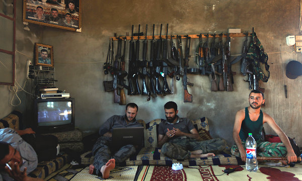 Syrian opposition fighters in Aleppo in 2012 (Photo: Associated Press)