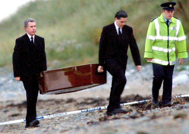 The remains of Jean McConville are removed from the Shelling Hill Beach location where they were finally found in 2003 (Photo: Alan Lewis)