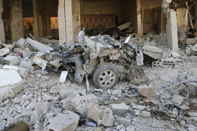 Wreckage of a car in Kaheel village, Syria (Photo: Mohamed Fares/ Thomson Reuters)