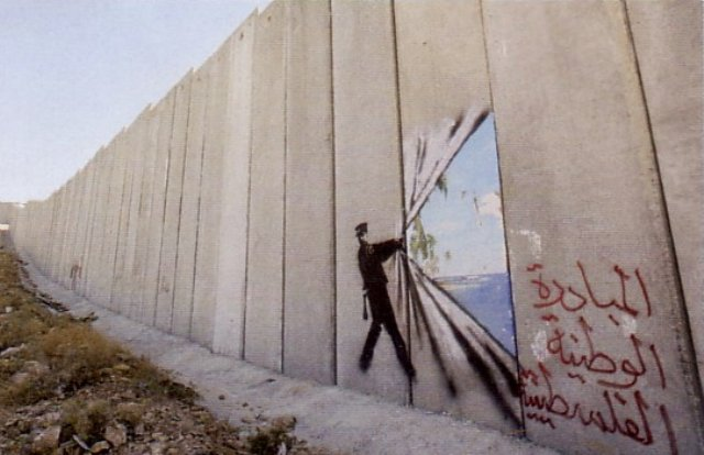 Bansky art on the Israel West Bank wall (Photo: Buzzfeed)
