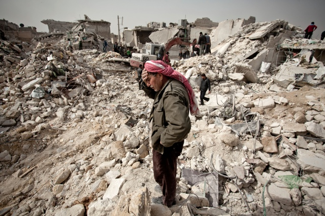 (A man scours rubble in Aleppo. Photo: Pablo Tosco / AFP / Getty Images)