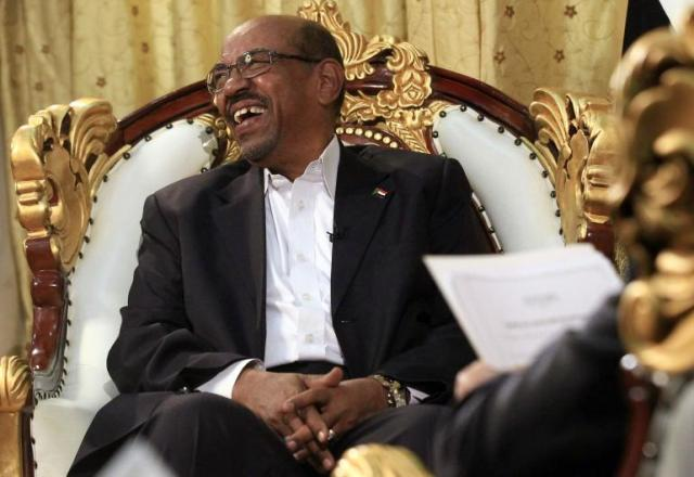 Omar al-Bashir, indicted by the ICC on charges of war crimes, crimes against humanity, and genocide, seems mostly unconcerned about the Court's arrest warrant against him. (Photo:  Mohamed Nureldin Abdallah / Reuters)