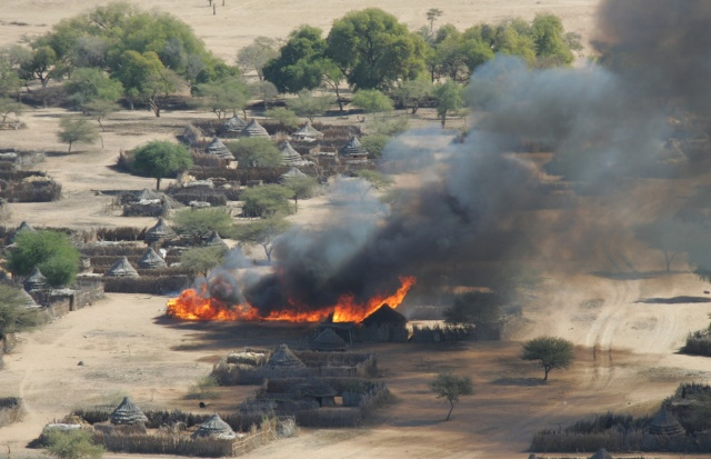 A village in Darfur burns following an attack (Photo: Eric Reeves)