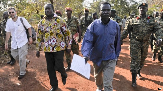 Dominic Ongwen walks with members of an African Union Regional Task Force prior to his surrender to the ICC (Photo: AP)