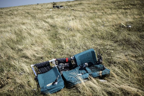 A row of empty seats from flight MH17 lies in a field in eastern Ukraine (Photo: Getty)