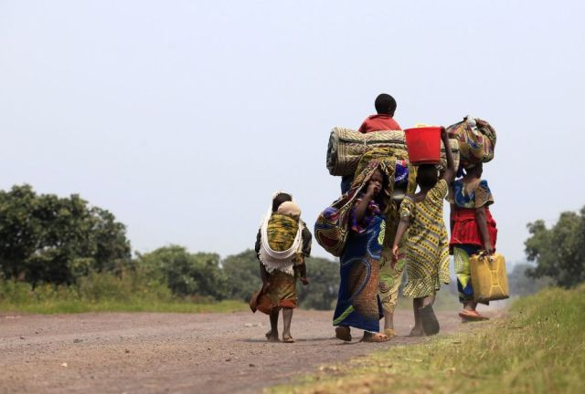 A family flees violence and heads towards Goma in the Eastern DRC (Photo: James Akena / Reuters)