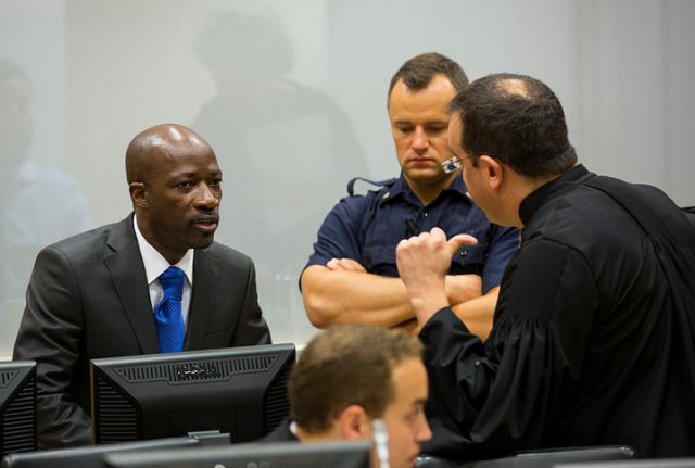 Charles Blé Goudé consults his defence counsel at the International Criminal Court (Photo: ICC)