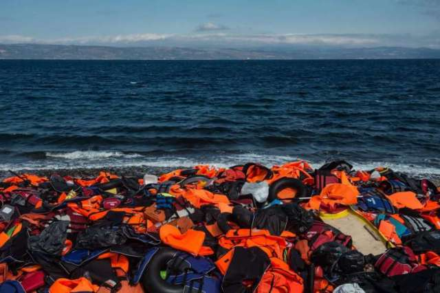 Life jackets from refugees escaping violence in Syria and elsewhere lay strewn on the shores of Lesbos, Greece. (Photo: EPA)
