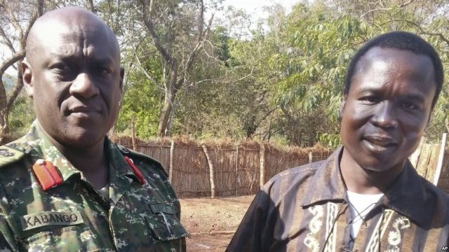 Col Michael Kabango of the UPDF stands with Dominic Ongwen shortly after coming into Ugandan custody (Photo: AP)