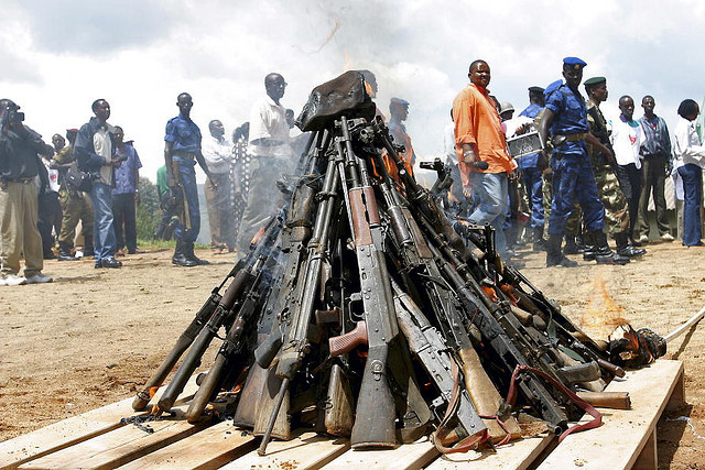 Weapons being burnt during the official launch of the Disarmament, Demobilization, Rehabilitation and Reintegration (DDRR) process in Muramvya, Burundi. Burundian military signed up voluntarily to be disarmed under the auspices of United Nations peacekeepers and observers.   2/Dec/2004. Muramvya, Burundi. UN Photo/Martine Perret. www.un.org/av/photo/