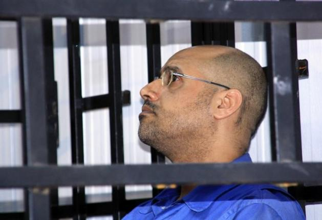 Saif al-Islam Gaddafi, attends a trial hearing in a courtroom in Zintan in May 2014 (Photo: Reuters / Stringer)