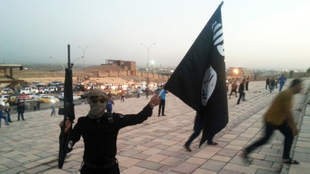 An ISIS fighters waves a flag in Iraq (Photo: Reuters)