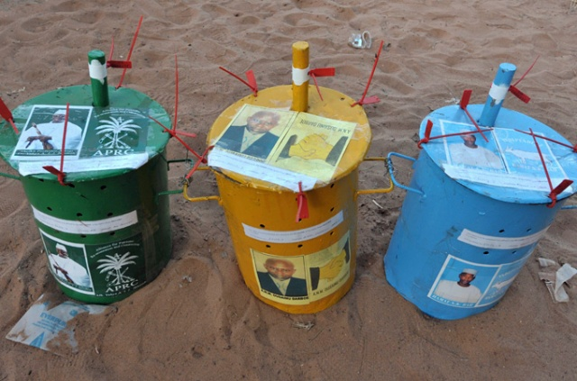 Canisters in which voters in The Gambia drop marbles to indicate their political support (Photo: AFP)